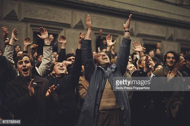 Students and residents of Prague Czechoslovakia demonstrate clap and shout on a street in the capital in August 1968 in protest against the Soviet...