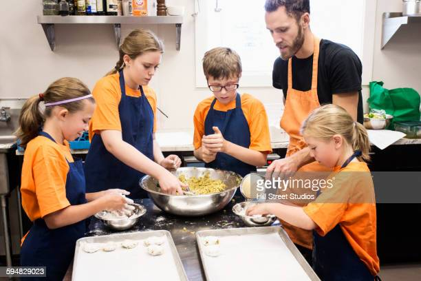 Students and teacher cooking in class