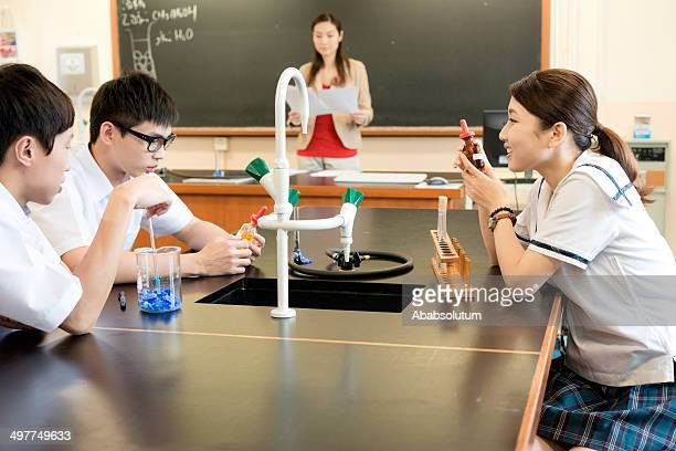 students and teacher in chemistry lab, hong kong, asia - visual china group stock pictures, royalty-free photos & images
