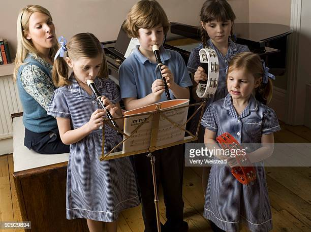 Students and teacher in music class