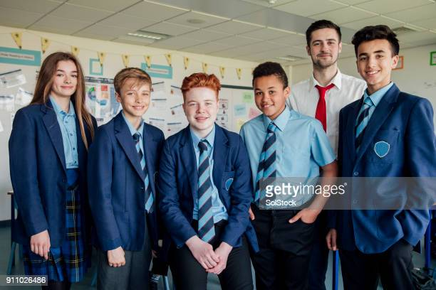 students and teacher - uniform stock pictures, royalty-free photos & images