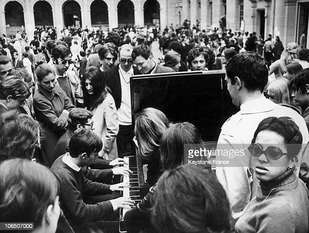 Students And Teachers Around A Piano Put In The Yard Of The Sorbonne