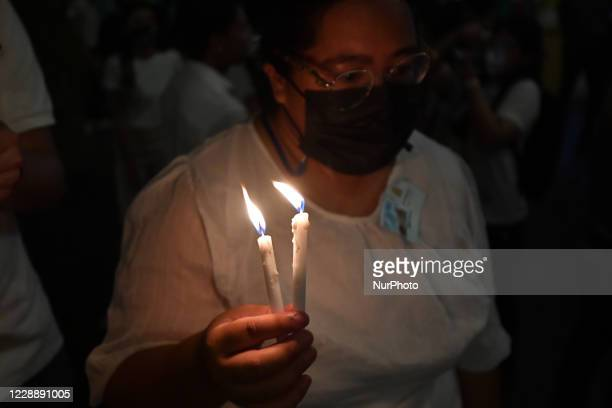 Students and teachers gathered inside Ministry of Education to read statement and claims and lighting candles to mark against violence, threat and...
