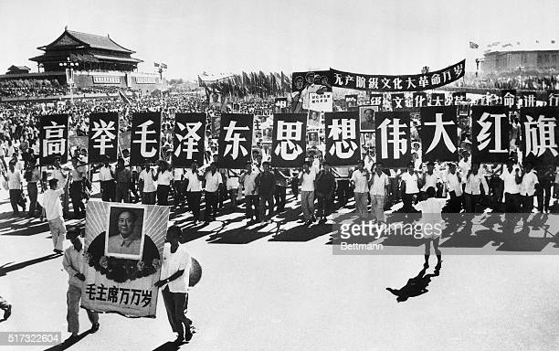 Students and teacher's march through Beijing's Tienan Men Square in support of Chairman Mao Zedong They hold placards reading 'Raise High Mao...