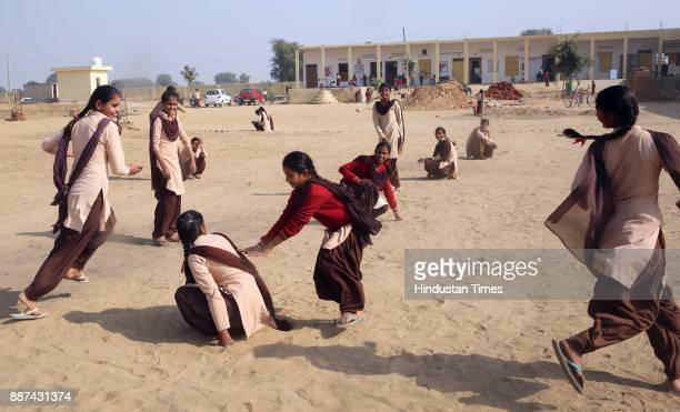 Students and teachers play during the sports break at Shaheed Balwant Singh Government Model Senior Secondary School in Ujholi Kot Kasim District...