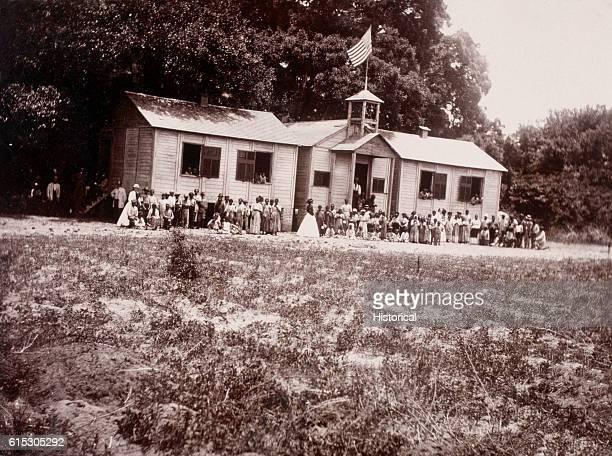 Students and teachers pose outside the Freedmen's Bureau school in Beaufort South Carolina