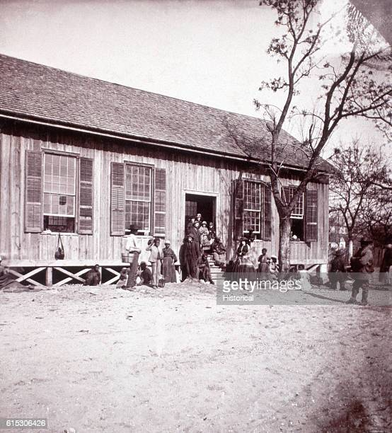 Students and teachers pose outside the Freedmen's Bureau school on Edisto Island South Carolina