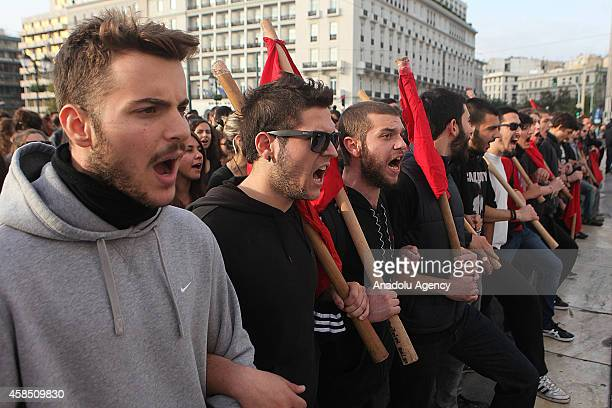 Students and teachers shout slogans during a protest against the law New High School which has been voted by the Greek government for the structural...