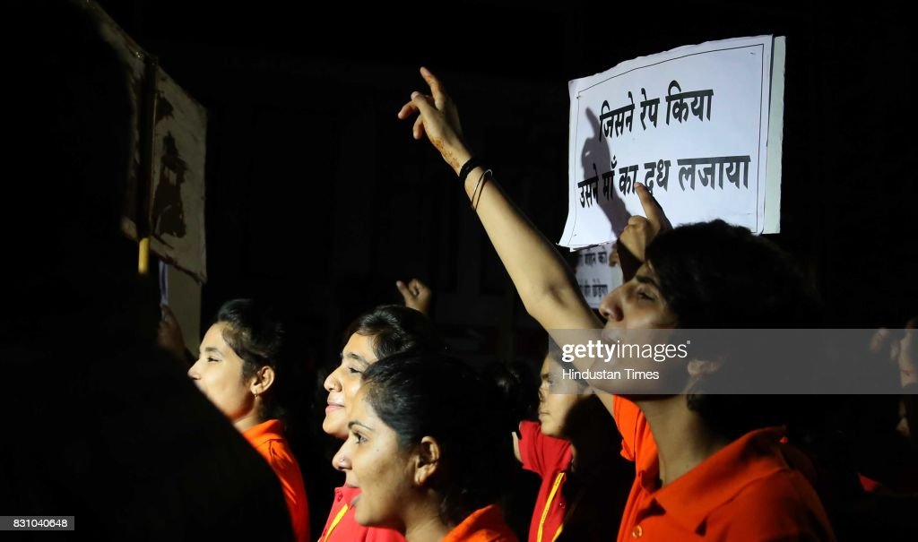 Students and teachers shout slogans during the 'Meri Raat Meri Sadak' campaign in which thousands of girls and boys from Parishkar College too