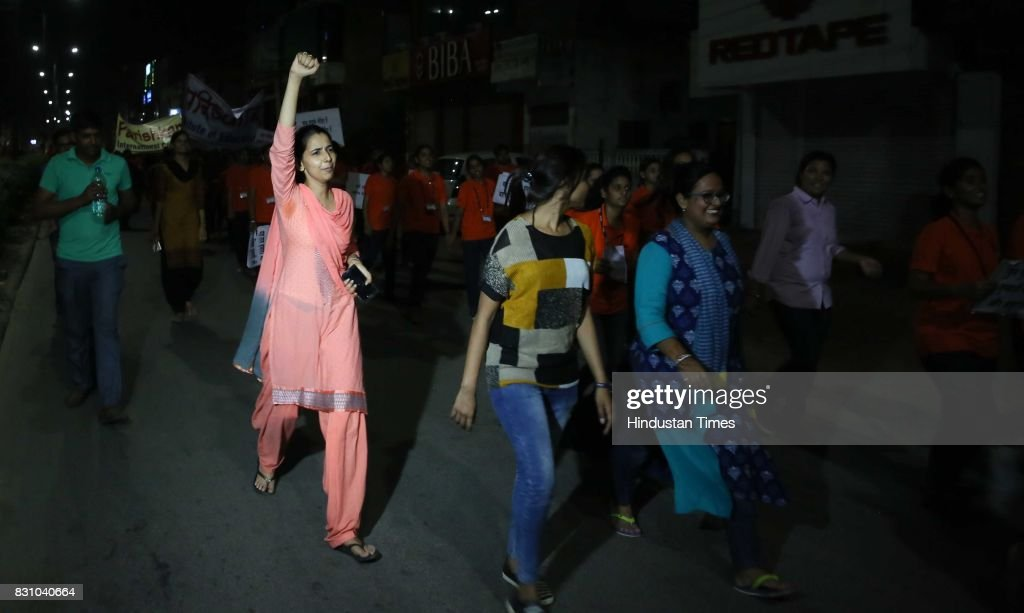 Students and teachers shout slogans during the `Meri Raat Meri Sadak` campaign in which thousands of girls and boys from Parishkar College took out a.