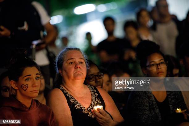 UNLV students and their families gather during a candle light vigil for the victims of the mass shootings that killed 59 people and injured more than...