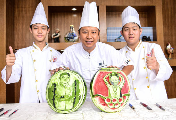 CHN: Students Carve Olympic Medalists' Portraits On Watermelons In Shenyang