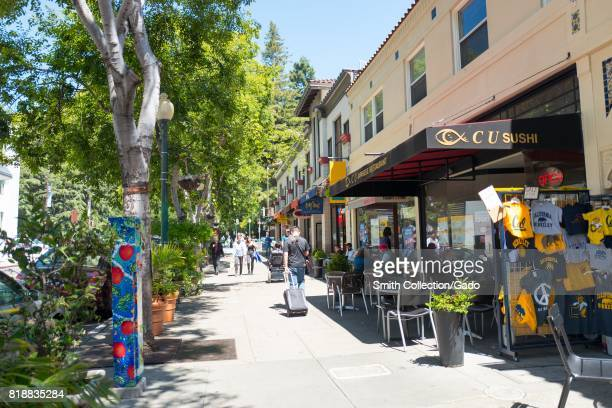 Students and tourists walk through the trendy Center Street area near UC Berkeley in downtown Berkeley, California, July 14, 2017.
