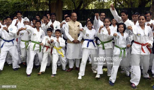 Students and trainer of Taekwondo meet Minister of State for Youth Affairs Sports Vijay Goel at his residence on June 14 2017 in New Delhi India