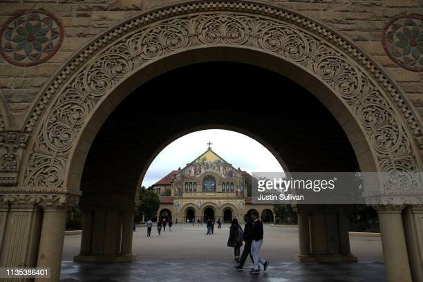 Students and visitors walk on the Stanford University campus on March 12 2019 in Stanford California More than 40 people including actresses Lori...