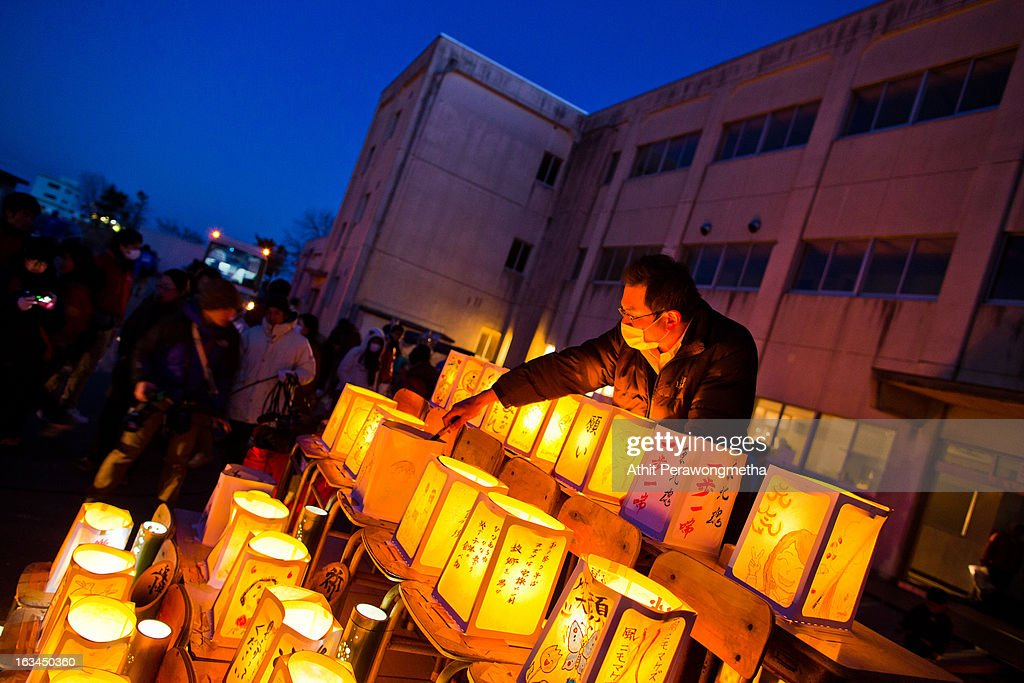 Students and volunteers gather and light candles at Yuriage Junior Hight School during a ceremony prior to the second anniversary commemoration of the tsunami and earthquake on March 10, 2013 in Natori, Japan. Japan on March 11 will commemorate the second anniversary of the magnitude 9.0 earthquake and following tsunami, that claimed more than 18,000 lives.