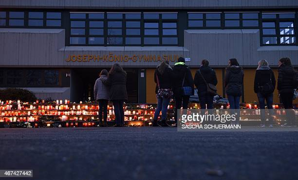 Students and well wishers gather at a memorial of flowers and candles in front of the JosephKoenigGymnasium secondary school in Haltern am See...