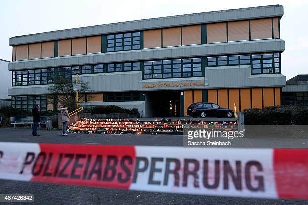 Students and well wishers gather in front of the JosephKoenigGymnasium secondary school in Haltern am See Germany on March 24 from where some of the...