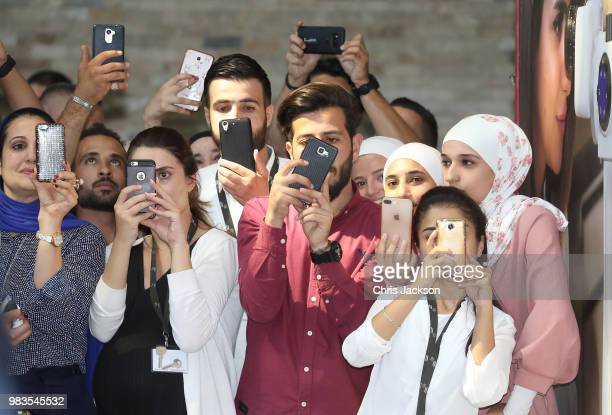 Students and wellwishers take photos as Prince William Duke of Cambridge visits vocational training college Al Quds which has links to Middlesex...