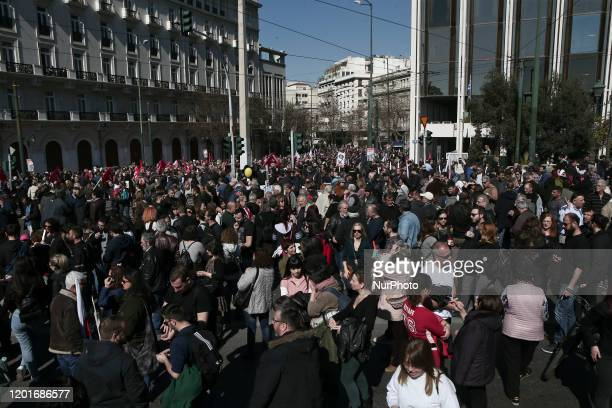 Students and workers demonstrate in central Athens during a nationwide general strike in protest at social security reforms being implemented by the...
