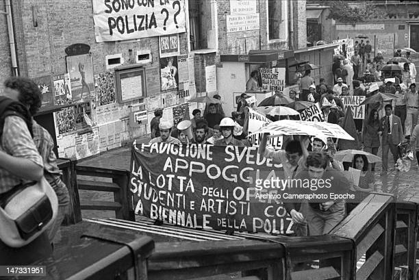Students and workers holding banners against the Biennale crossing the Accademia bridge Venice 1968