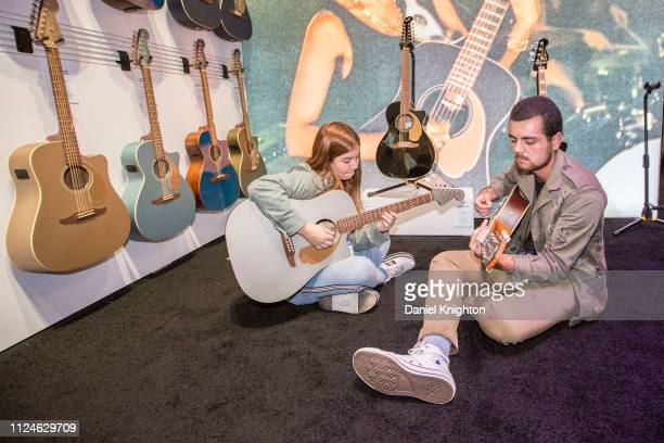 Students Andrea Ferrero and Alejandro Muhech jam at the Fender booth at Anaheim Convention Center on January 24 2019 in Anaheim California