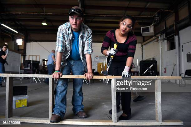 Students Andrew Parker left and Rafelina Garibay right learn how to make concrete forms during the Construction Careers Now program at the Central 70...