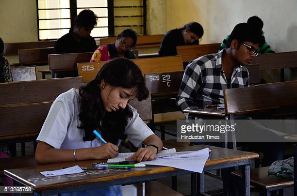 Students appear for the CBSE class 12th examinations at Govt. Subhash School of Excellence on March 1, 2016 in Bhopal, India. CBSE class X and XII...