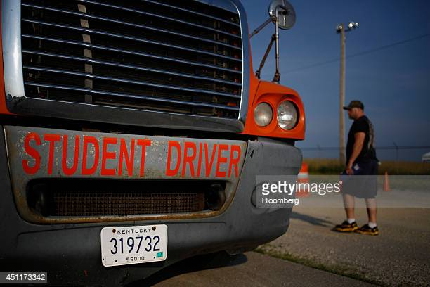 A students approaches a tractor trailer during a commercial drivers license class at Lake Cumberland CDL Training School in Mt Sterling Kentucky US...