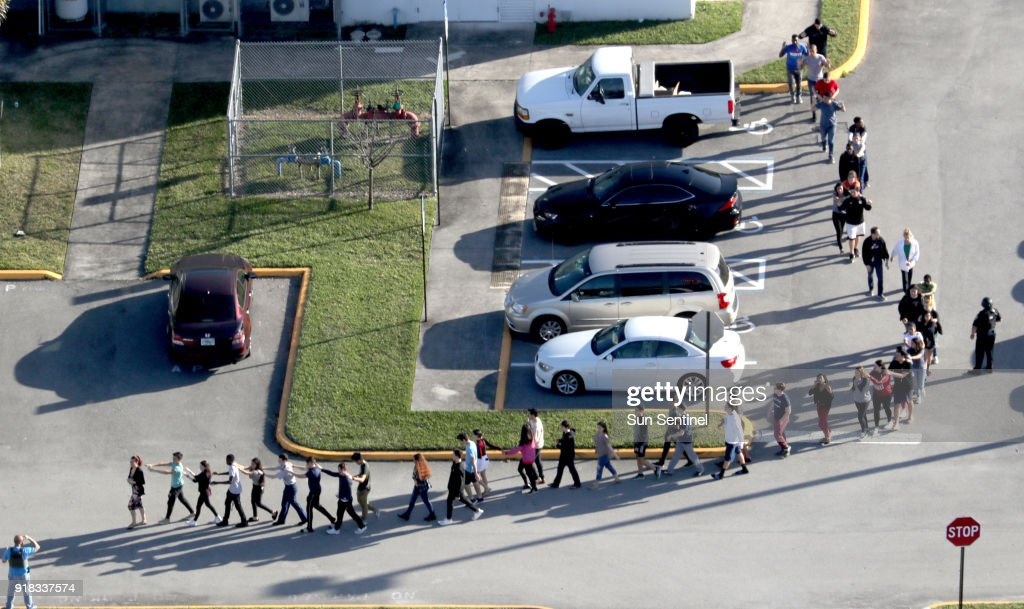Psyop Marjory Stoneman Douglas High School Students-are-evacuated-by-police-out-of-stoneman-douglas-high-school-picture-id918337574