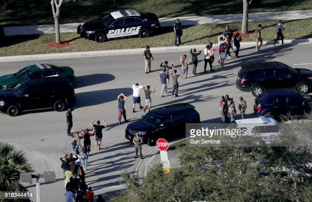 Students are evacuated by police out of Stoneman Douglas High School in Parkland Fla after a shooting on Wednesday Feb 14 2018