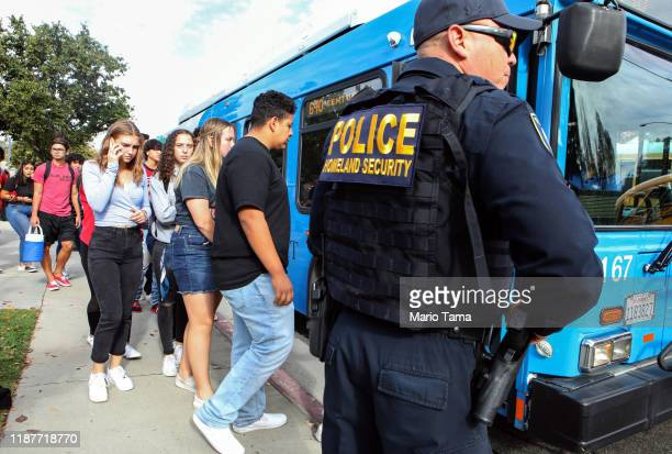 Students are evacuated from Saugus High School onto a bus after a shooting at the school left two students dead and three wounded on November 14 2019...