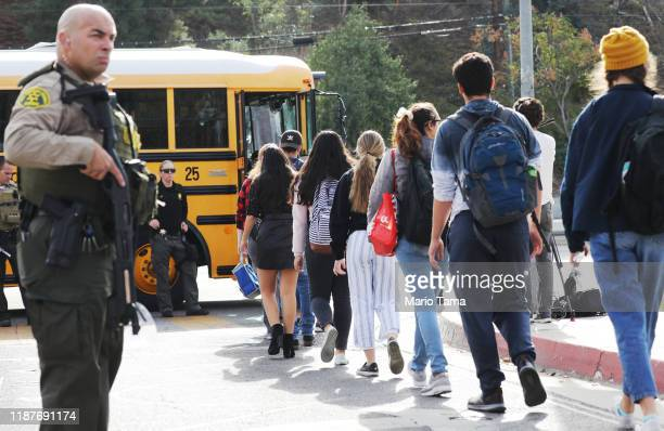 Students are evacuated from Saugus High School onto a school bus after a shooting at the school left two students dead and three wounded on November...
