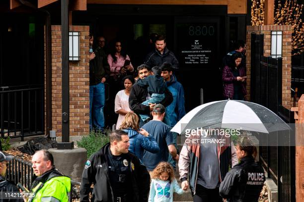 Students are evacuated from the Recreation Center at Northridge in Highlands Ranch after a shooting at the STEM School Highlands Ranch on May 7 2019...