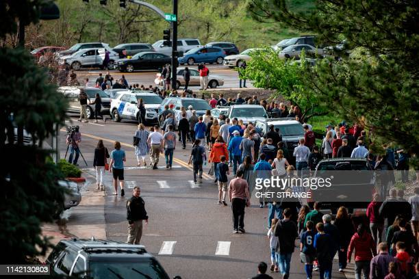 Students are evacuated from the Recreation Center at Northridge in Highlands Ranch after a shooting at the STEM School Highlands Ranch on May 7,...