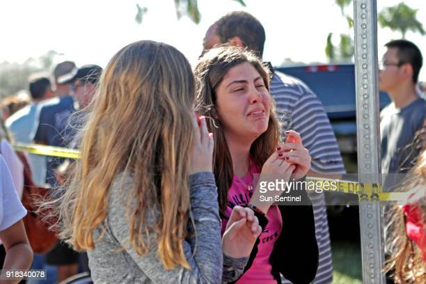 Students are released from a lockdown outside of Stoneman Douglas High School in Parkland Fla after a shooting on Wednesday Feb 14 2018