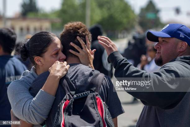 Students are reunited with friends and family after a shooting at Highland High School on May 11 2018 in Palmdale California A 14yearold male student...