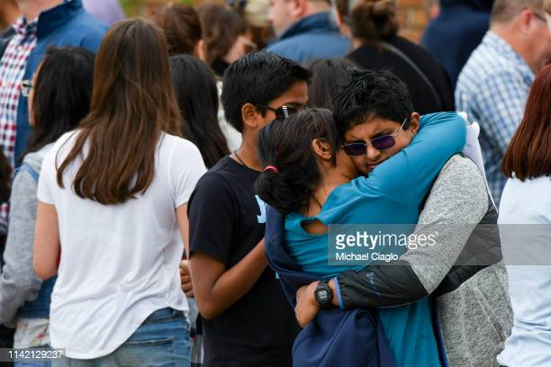 Students are reunited with their parents after being evacuated to the Recreation Center at Northridge after at least seven students were injured...