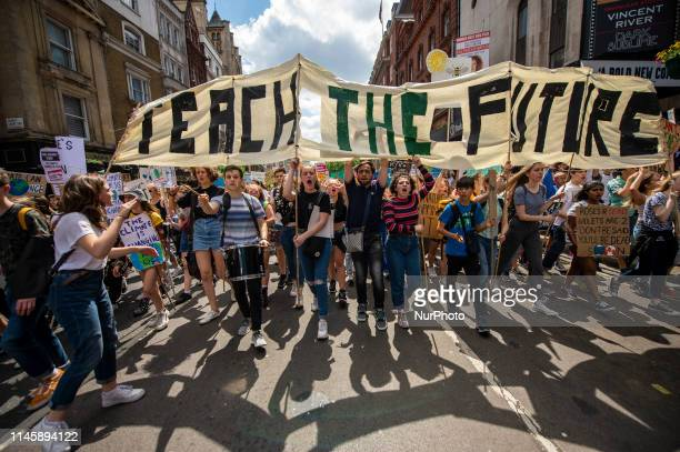 """Students are seen holding up a banner which reads """" Teach The Future""""during a demonstration in London, United Kingdom on 24 May 2019...."""