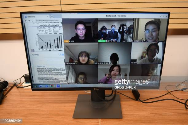 Students are seen on a screen during an online class taken by Professor Gao Yuning at the School of Public Policy and Management at Tsinghua...