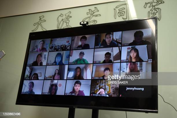 Students are seen on a screen during an online class taken by teacher Fu Zhiyong at the Academy of Arts and Design at Tsinghua University during a...