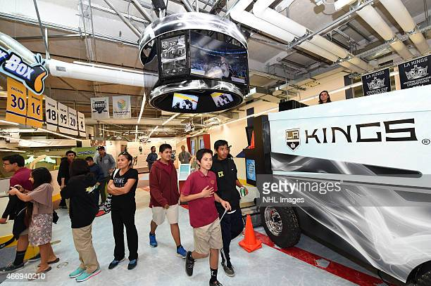 Students are seen walking through attractions during the grand opening of the LA Kings Science of Hockey exhibit at Discovery Cube Los Angeles on...