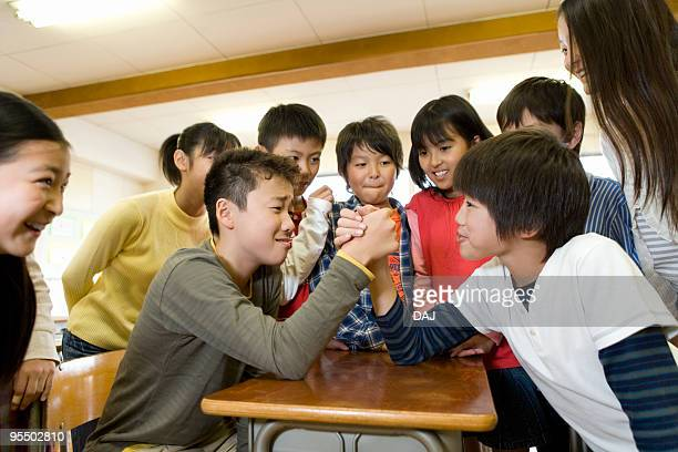 Students arm wrestling