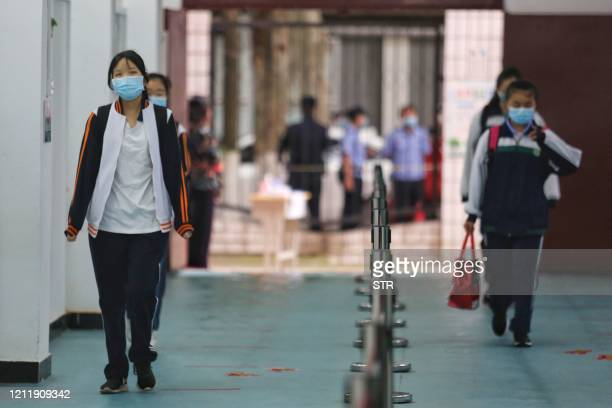 Students arrive at a high school in Wuhan in China's central Hubei province on May 6 2020 Senior school students returned to class on May 6 in the...