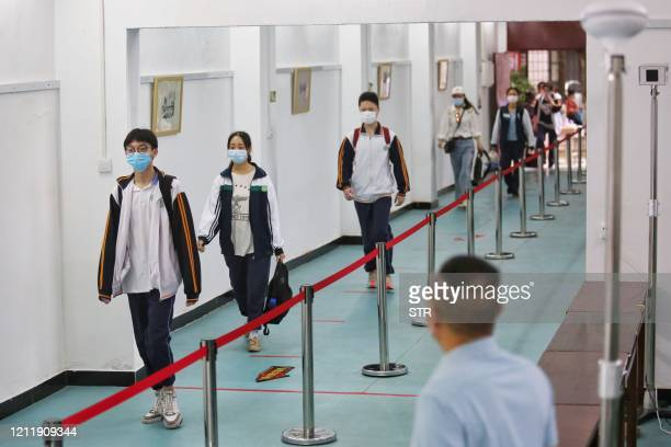 Students arrive at a high school in Wuhan in China's central Hubei province on May 6, 2020. - Senior school students returned to class on May 6 in...