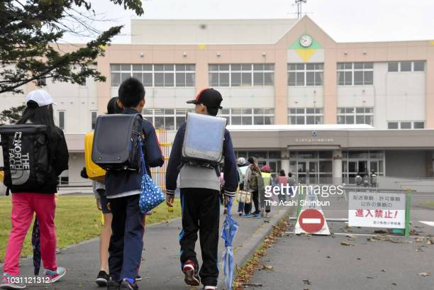 Students arrive at an elementary school as classes resumed after temporary closure following the earthquake on September 10 2018 in Sapporo Hokkaido...