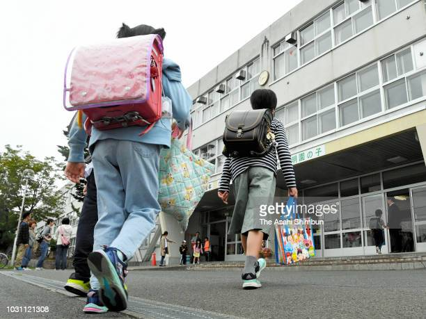 Students arrive at Meien Elementary School as classes resumed after temporary closure following the earthquake on September 10 2018 in Sapporo...