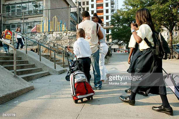 Students arrive at PS 36 on Amsterdam Avenue on the first day back to school for New York City public school students September 8 2003 in New York...