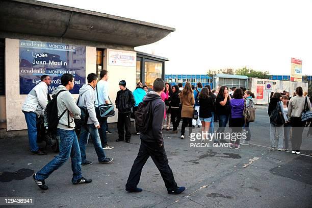 Students arrive at the Jean Moulin high school on October 17 2011 in Beziers southern France before a march in memory of Lyse Bonnafous who committed...