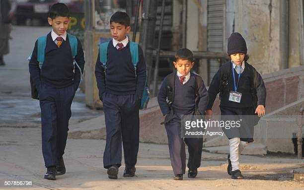 Students arrive at their schools which were reopened after being closed for one week due to security threats by Taliban militants following their...